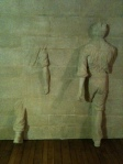 statues thru wall